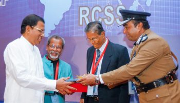 H.E President Maithripala Sirisena receiving a token of appreciation from Mr. Pujith Jayasundara, IGP, Sri Lanka; Prof. Imtiaz Ahmed, Executive Director, RCSS and Prof. Siri Hettige, Chairman, National Police Commission